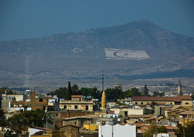 Flag of the self-declared Turkish Republic of Northern Cyprus in the hills above Cyprus' capital Nicosia.