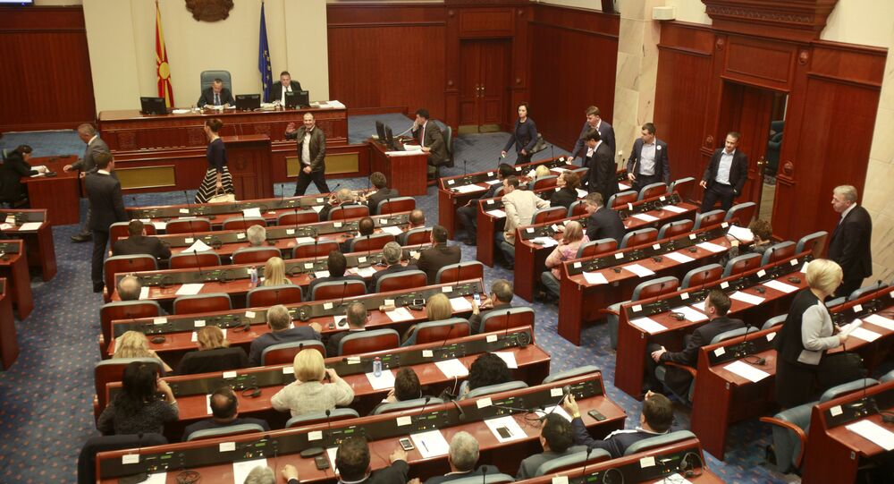Lawmakers gather on an urgent session, in the Parliament building in Macedonia's capital Skopje, on Wednesday, May 18, 2016
