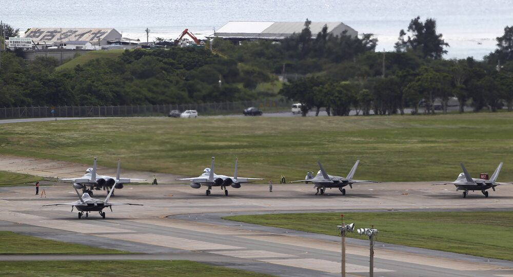 U.S. Air Force F-22 Raptors, right, and two F-15 Eagles prepare for take-off at Kadena Air Base on the southern island of Okinawa, in Japan (File)