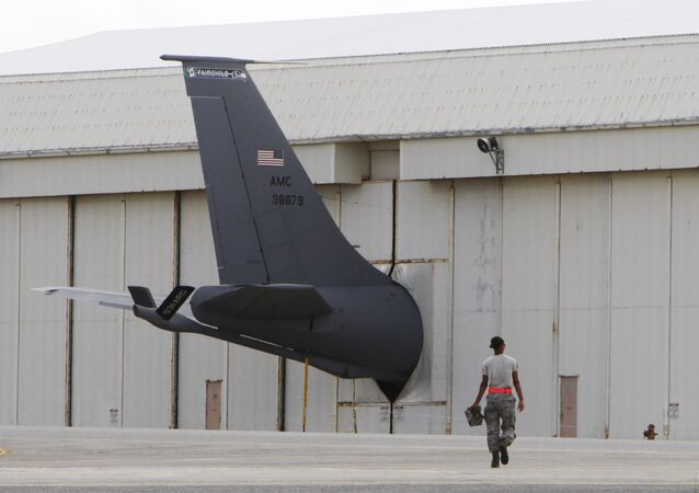 A ground crew member walks towards the tail of a U.S. Air Force KC-135 Stratotanker protruding from a hanger at Kadena Air Base on Japan's southwestern island of Okinawa (File)