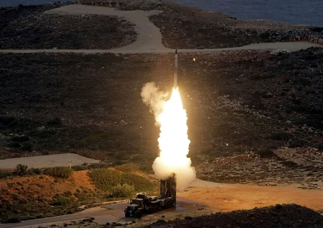 An S-300 PMU-1 anti-aircraft missile launches during a Greek army military exercise near Chania on the island of Crete on December 13, 2013