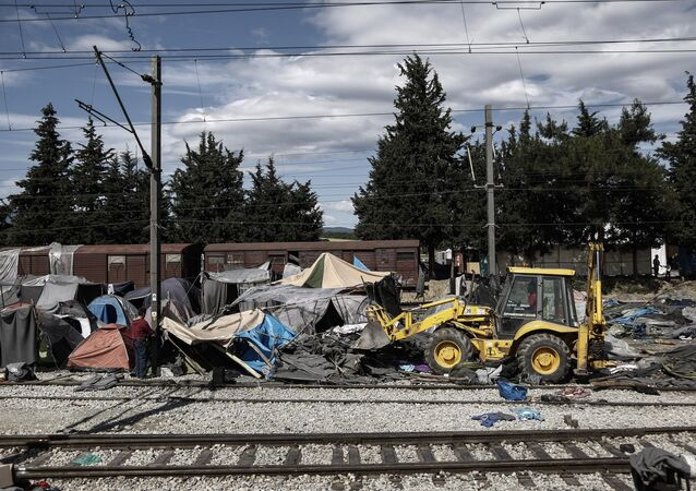 A bulldozer clears the debris at the site of the makeshift refugee and migrant camp in Idomeni close to the Greek-Macedonian border on May 25, 2016