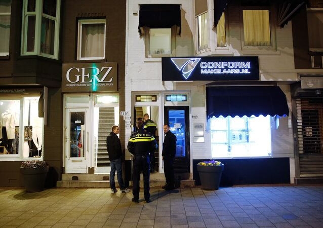 Police search a house in Oudedijk in the Kralingen district, in Rotterdam, on March 30, 2016