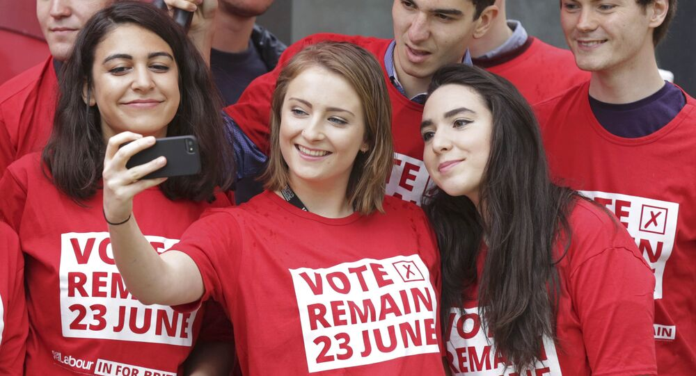 Labour Party activists take selfie photographs during the launch of the party's Labour In for Britain campaign bus, in London, Britain May 10, 2016.