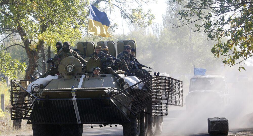 Ukrainian troops patrol in armored vehicles (File)