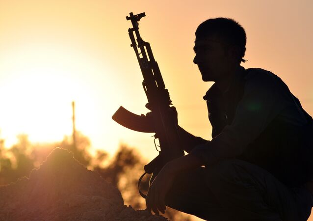 A fighter from the Kurdish People Protection Unit (YPG) poses for a photo at sunset in the Syrian town of Ain Issi, some 50 kilometres north of Raqqa, the self-proclaimed capital of the Islamic State (IS) group during clashes between IS group jihadists and YPG fighters on July 10, 2015A fighter from the Kurdish People Protection Unit (YPG) poses for a photo at sunset in the Syrian town of Ain Issi, some 50 kilometres north of Raqqa, the self-proclaimed capital of the Islamic State (IS) group during clashes between IS group jihadists and YPG fighters on July 10, 2015