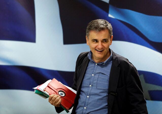 Greek Finance Minister Euclid Tsakalotos arrives for a news conference at the ministry in Athens, Greece May 26, 2016