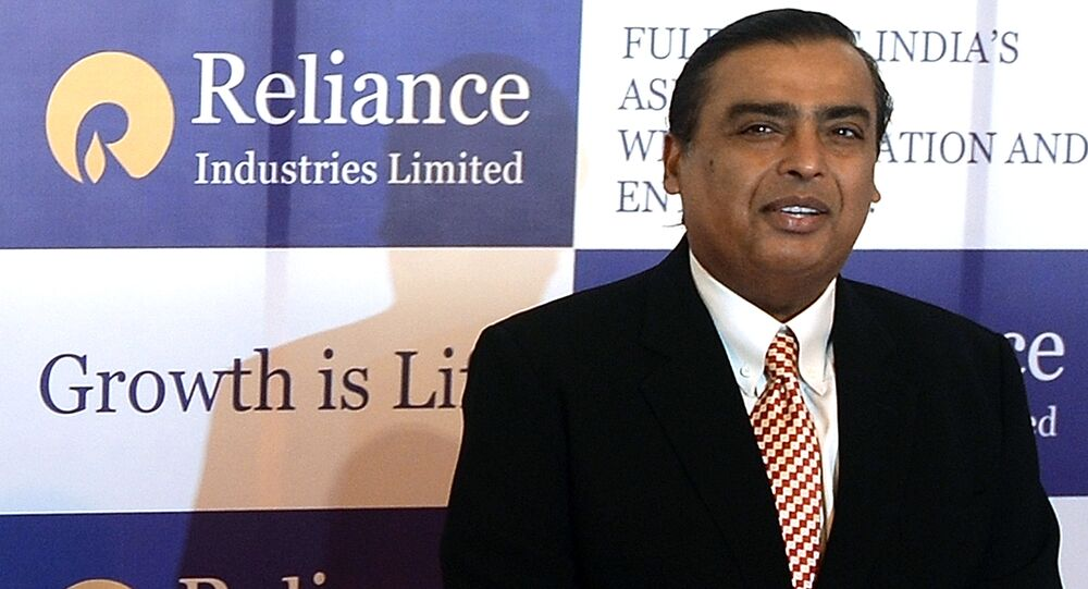 Reliance Industries Chairman Mukesh Ambani poses as he arrives for the company's annual general meeting in Mumbai on June 6, 2013