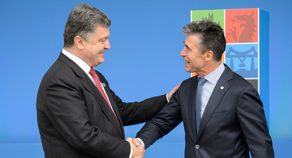 NATO Secretary General Anders Fogh Rasmussen (R) greets Ukrainian President Petro Poroshenko (L) during the 2014 NATO Summit in Newport, Wales, on September 4, 2014