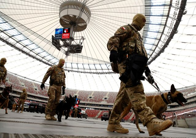 Soldiers walk after demonstration of their skills during a military police exercise before the NATO summit in July in Warsaw at the PGE National Stadium in Warsaw, Poland May 24, 2016