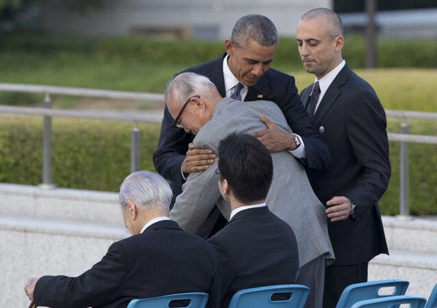 U.S. President Barack Obama hugs Shigeaki Mori, an atomic bomb survivor and a creator of the memorial for American WWII POWs killed in Hiroshima, during a ceremony at Hiroshima Peace Memorial Park in Hiroshima, western, Japan, Friday, May 27, 2016. Obama on Friday became the first sitting U.S. president to visit the site of the world's first atomic bomb attack, bringing global attention both to survivors and to his unfulfilled vision of a world without nuclear weapons.