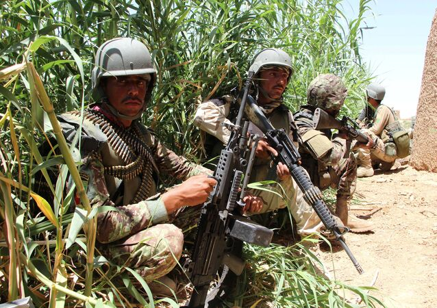 Afghan National Army (ANA) soldiers keep watch at an outpost in Marjah district of Helmand province, Afghanistan.