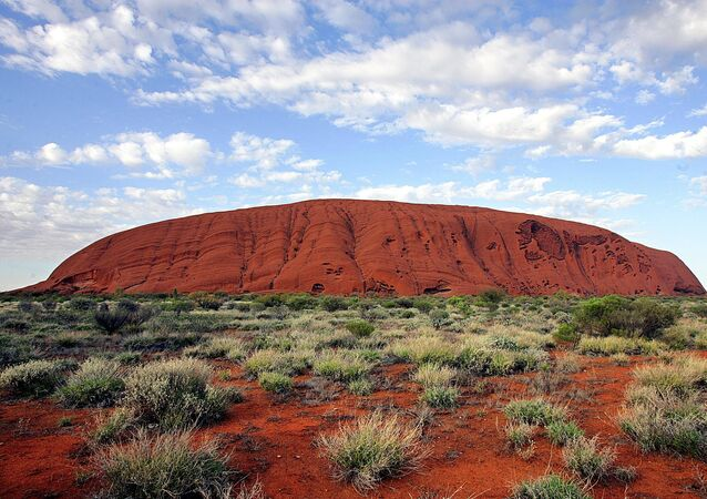The monolith of Uluru (Ayers Rock) rises 340 metres above the ochre plain in the World Hertage-listed Uluru-Kata Tjuta National Park, which encompasses 1,325 square kilometres of desert in Central Australia.