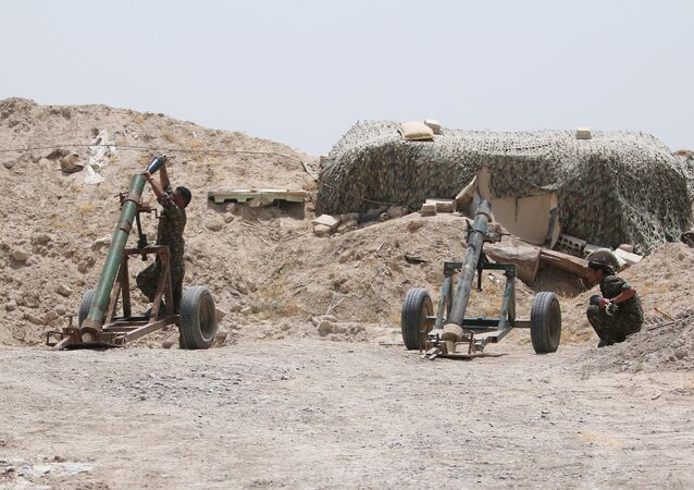 Fighters of the Syria Democratic Forces prepare to fire a mortar shell towards positions held by Daesh fighters in northern province of Raqqa, Syria May 27, 2016