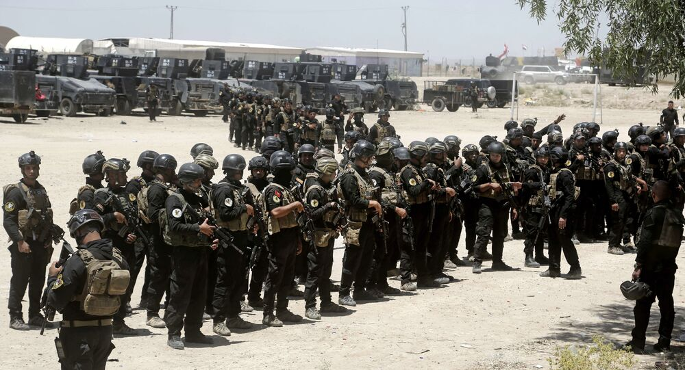 Iraq's elite counter-terrorism forces gather ahead of an operation to re-take the Daesh-held City of Fallujah, outside Fallujah, Iraq, Sunday, May 29, 2016.