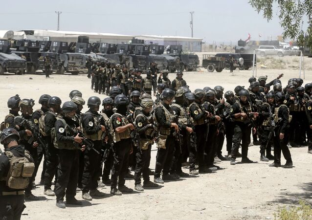 Iraq's elite counter-terrorism forces gather ahead of an operation to re-take the Islamic State-held City of Fallujah, outside Fallujah, Iraq, Sunday, May 29, 2016.