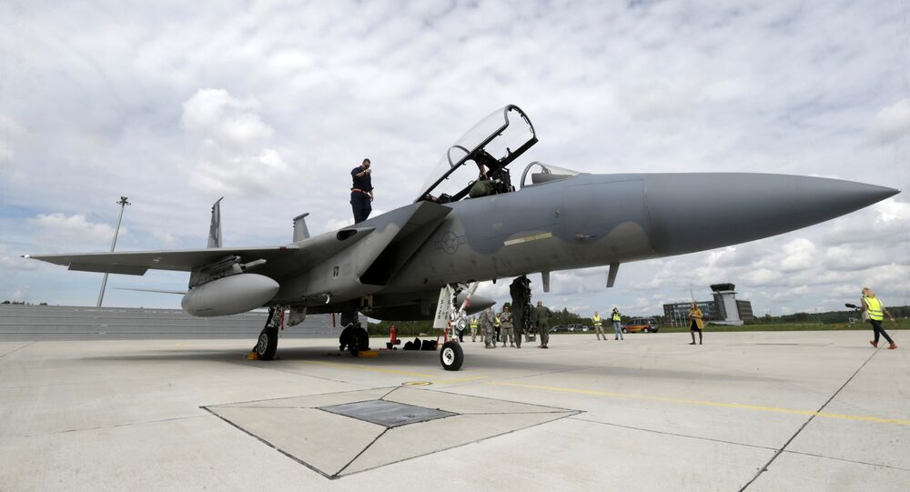 A specialist inspects a U.S Air Force F-15 Eagle fighter after a certification of the arresting gear in the military air base in Lielvarde, Latvia, May 19, 2016.