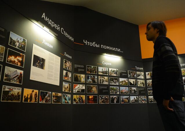 Photographic exhibition of MIA Rossiya Segodnya news agency photo correspondent Andrei Stenin killed in Ukraine on professional duty.
