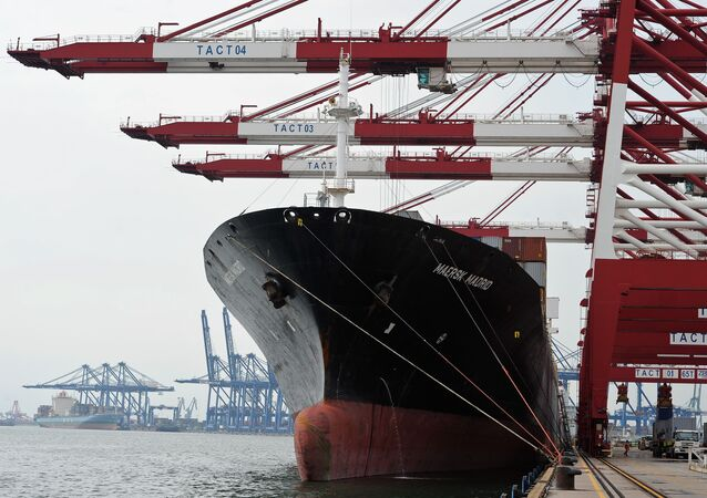 Containers are loaded onto a cargo ship at the Tianjin port in China