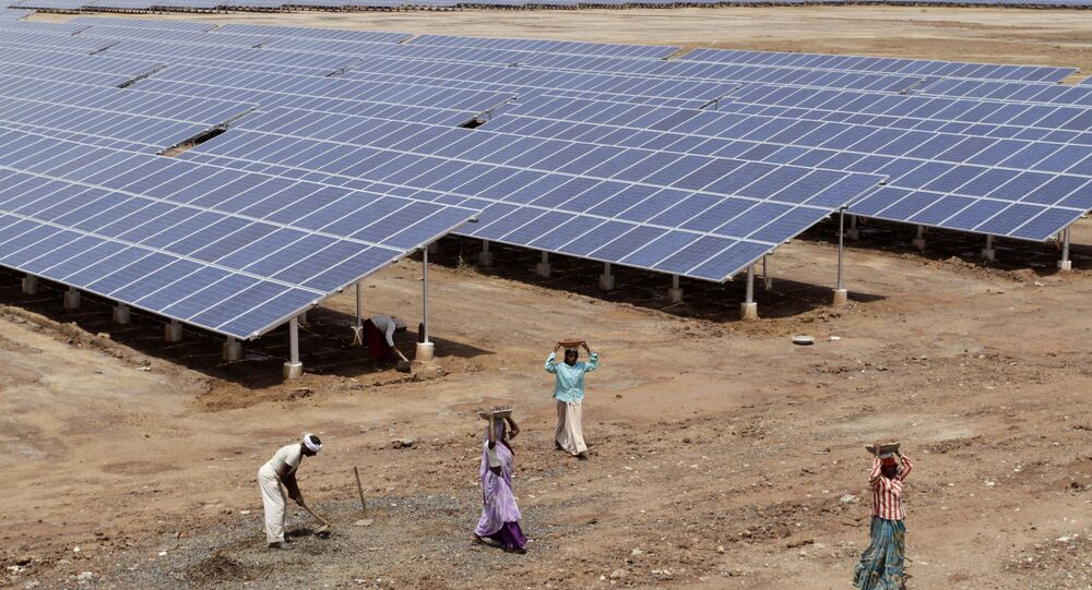Indian laborers work near solar panels at the Gujarat Solar Park at Charanka in Patan district, about 250 kilometers (155 miles) from Ahmadabad, India. (File)