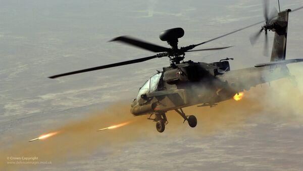 Apache Helicopter Firing Rockets - Sputnik International