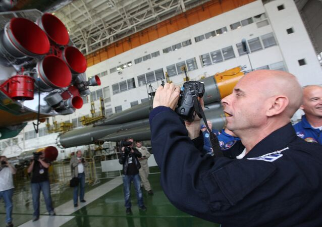 Space tourist Guy Laliberte of the 21st ISS mission main crew seen at a maintenance and checkout facility at the Baikonur Space Center. File photo