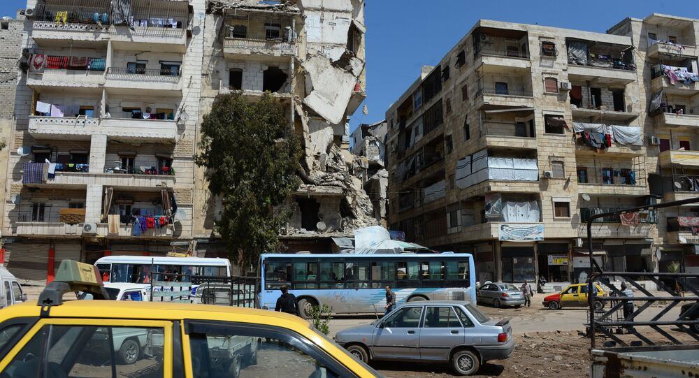 Local citizens continue to live in destroyed buildings in the Salah ad-Din District in Aleppo