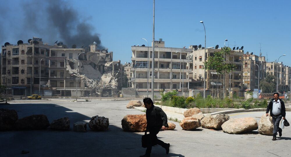 Militants shell a district in Aleppo