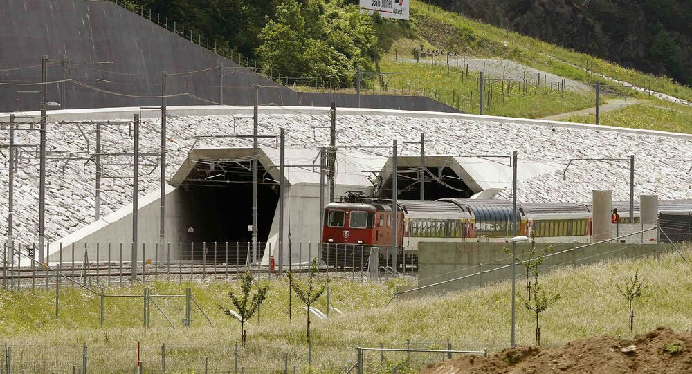 A train drives past the northern gates of the NEAT Gotthard Base Tunnel near the town of Erstfeld, Switzerland March 31, 2016