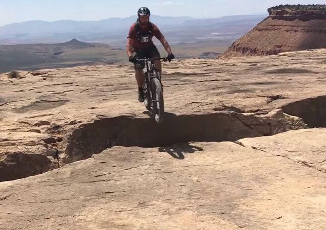 Rider almost falls off cliff