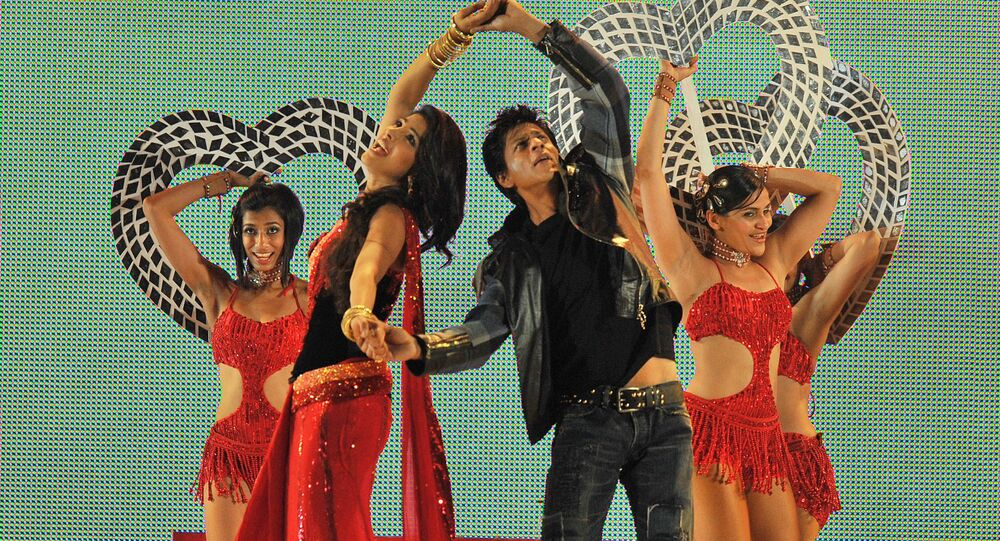 Bollywood actors Shahrukh Khan (2nd R) and Priyanka Chopra (2nd L) dance at the Moses Mabhida Stadium in Durban late on January 9, 2011 to mark the anniversary of the arrival of Indians in South Africa 150 years ago.