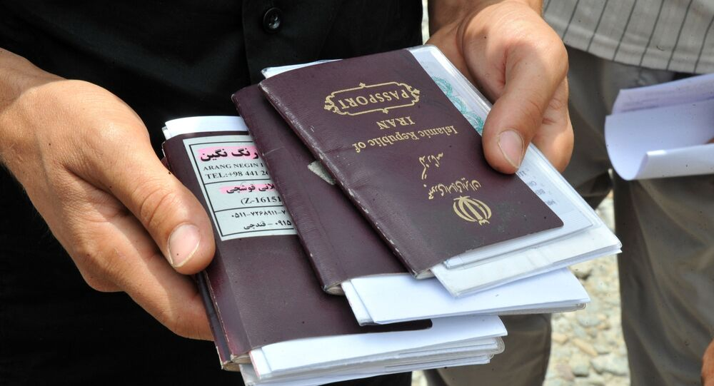 Iranian truck drivers collect their passports for border control near the Armenian town of Agarak on July 12, 2012 next to the border with Iran, in a region where the borders of Armenia, Azerbaijan, Iran and Turkey join.