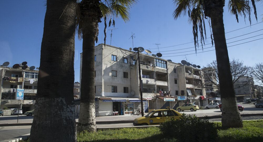 In this photo taken on Tuesday, March 1, 2016, a car passes on a street in Latakia, Syria