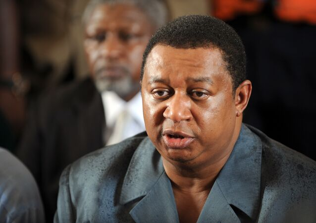 Managing director of Nigerian National Petroleum Corporation -NNPC- Mohammed Barkindo speaks after inspecting the burnt oil pipelines belonging to the Nigerian National Petroleum Corporation at the Altas Cove in Lagos after they have been destroyed with dynamite by the Movement for the Emancipation of Niger Delta overnight on July 13, 2009