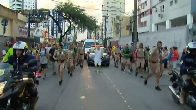 Man falls with the Olympic torch in Brazil