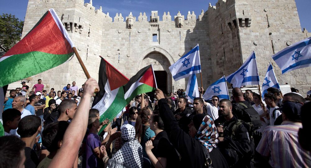 Israelis and Palestinians wave flags