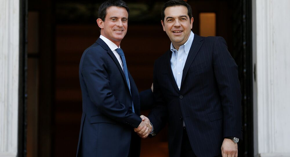 Greek Prime Minister Alexis Tsipras (R) welcomes his French counterpart Manuel Valls at the Maximos Mansion in Athens, Greece, June 3, 2016.