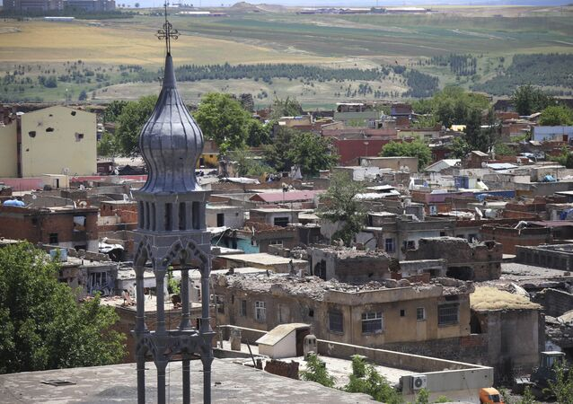 Many of the buildings and roof-tops show recent damage from recent military clashes in parts of the historic district of the mainly Kurdish city of Diyarbakir, southeastern Turkey, Sunday, May 22, 2016
