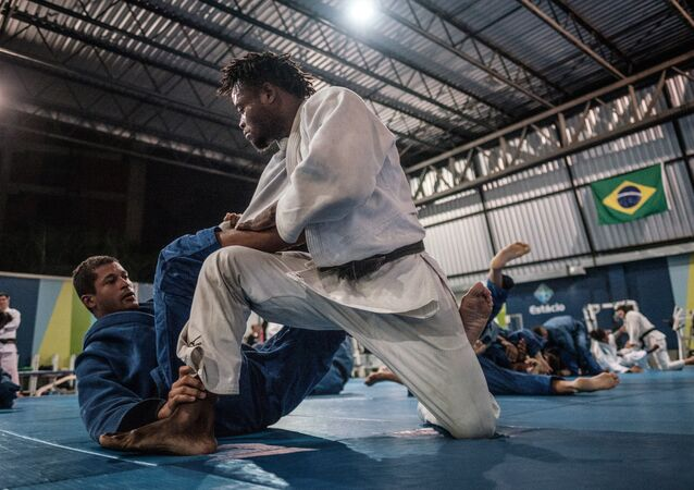 Popole Misenga, 24 (R), a refugee judoka from the Democratic Republic of Congo, during a training at Instituto Reacao in Rio de Janeiro, Brazil, on April 14, 2016. Misenga is a strong candidate for the newly created Refugees Olympic Athletes team for the Rio 2016 Olympic Games