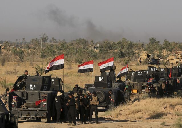 Smoke billows on the horizon as Iraqi military forces prepare for an offensive into Fallujah to retake the city from Islamic State militants in Iraq, Monday, May 30, 2016