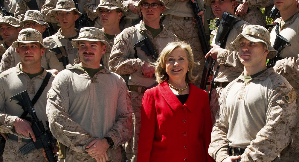 US Secretary of State Hillary Clinton poses for a photograph with members of the USMC FAST Marines, a quick response team from Norfolk, Virginia, on duty at the US Embassy in Cairo, on March 16, 2011