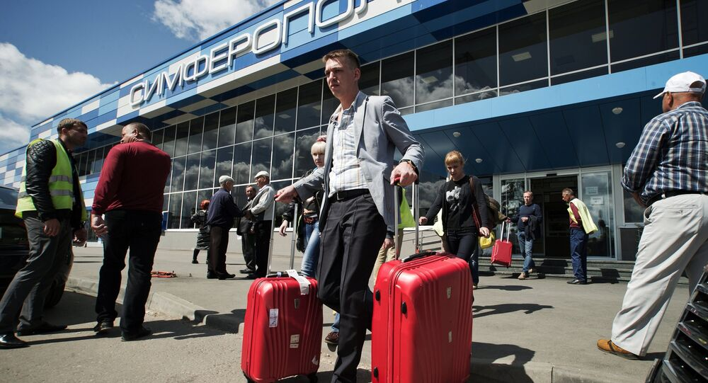Tourists seen leaving the Simferopol International Airport, on having arrived for vacations in the Crimea