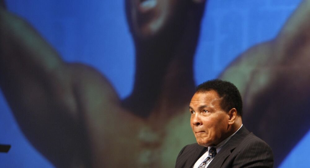 Muhammad Ali sits on the stage during an announcement marking a new philanthropic initiative in the Lexington Convention Center in Lexington, Ky., Tuesday, May 19, 2009