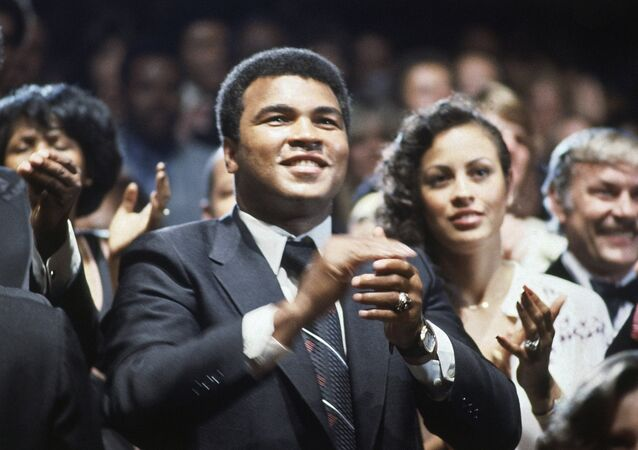 Heavyweight champ Muhammad Ali shown with wife, Veronica in Los Angeles at Los Angeles Lakers Basketball game on Sept. 6, 1979
