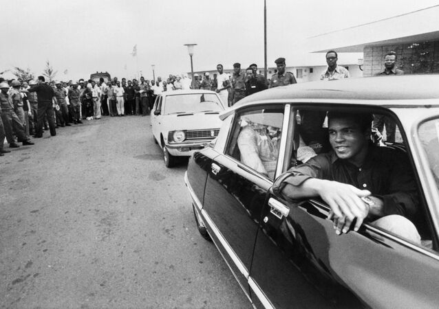 This file photo taken on September 28, 1974 shows former world heavyweight champion Muhammad Ali being welcomed by a cheering crowd in Kinshasa, Zaire, before his world heavyweight championship fight against titleholder US George Foreman on October 30, 1974