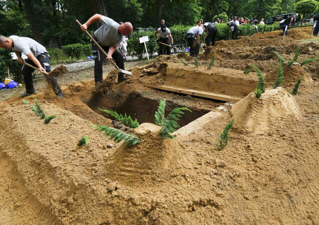 Gravediggers take part in the first Hungarian grave digging championship in Debrecen, Hungary, June 3, 2016, competing for the national crown, which is awarded based on accuracy, speed, and aesthetic quality