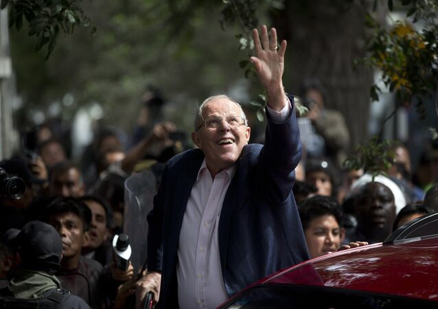 Presidential candidate Pedro Pablo Kuczynski of the Peruanos por el Kambio political party greets supporters after casting his vote in Lima, Peru, Sunday, June 5, 2016.