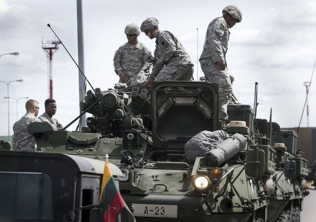 Members of the US Army of the Pennsylvania National Guard unload equipment as they arrive at a airport in Vilnius, Lithuania, Sunday, June 5, 2016.