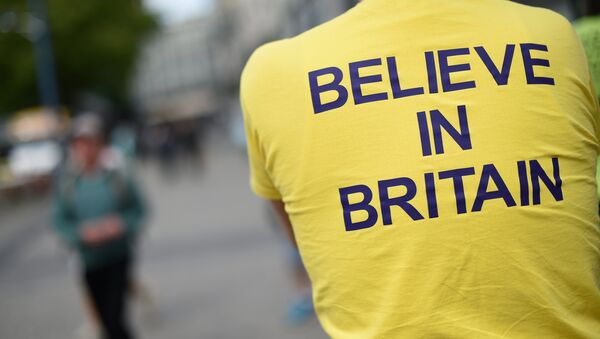 A campaigner wears a T-shirt bearing the slogan Believe In Britain as he attends an Anti-EU (European Union) United Kingdom Independence Party (UKIP) pro-Brexit campaign event, ahead of the forthcoming referendum, in Birmingham, central England, on May 31, 2016. - Sputnik International