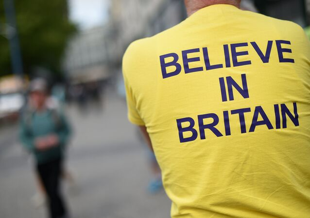 A campaigner wears a T-shirt bearing the slogan Believe In Britain as he attends an Anti-EU (European Union) United Kingdom Independence Party (UKIP) pro-Brexit campaign event, ahead of the forthcoming referendum, in Birmingham, central England, on May 31, 2016.